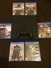 PS4 SLIM WITH 6 GAMES (ALL DISC)