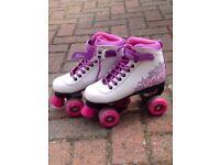 Four wheeled girls roller skates