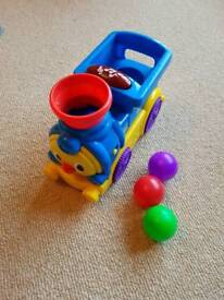 Bright starts rool and pop toy train