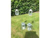 Galvanised lanterns (4) and two crooks.