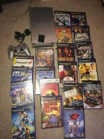 Silver Sony ps2 console and games