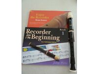 Aulos descant recorder and two books