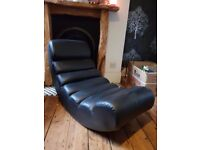 Curved chair - gaming or relaxing