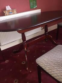 Mahogany extending dining table and chairs