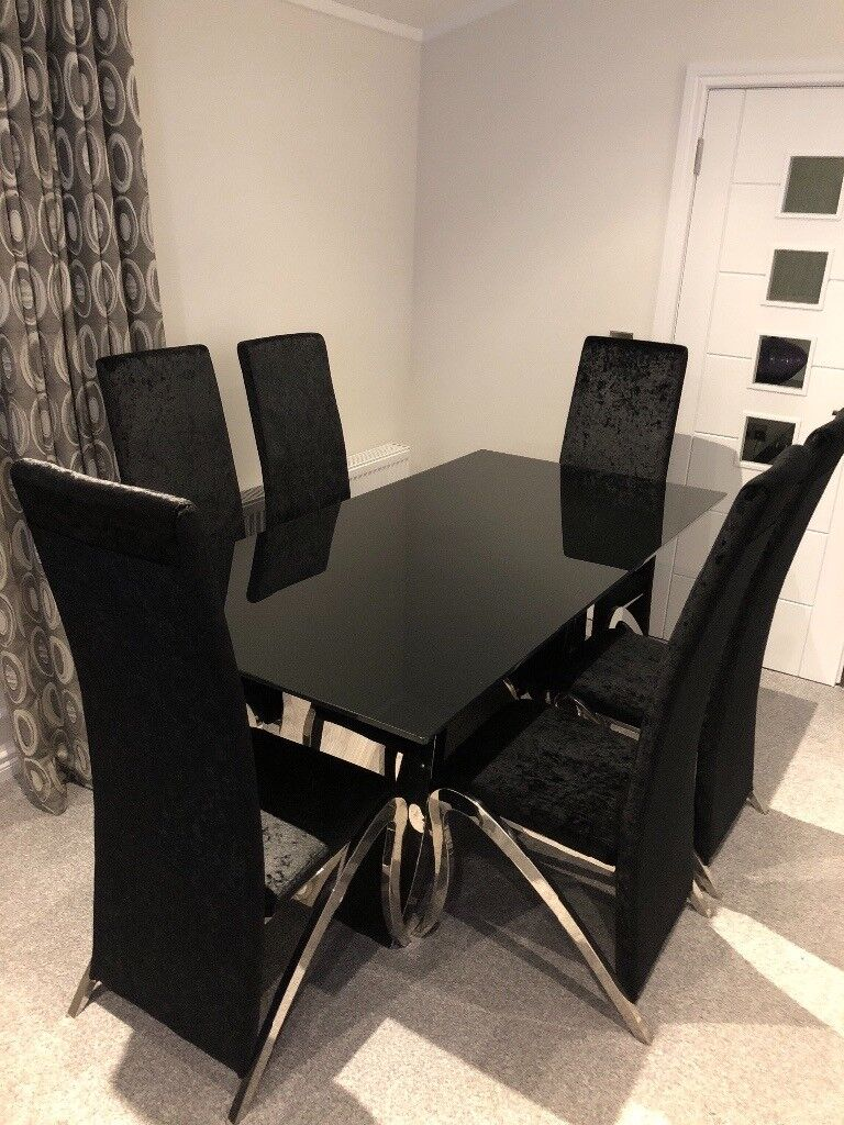 Mystique dining table and 6 black velvet chairs