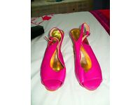 size 5 pink wedges with adjustable strap on heel,never worn excellent condition