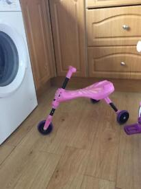 Pink scuttle bug and little tykes trike