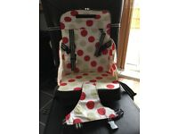 Good condition booster seat. Fits to all chairs and safely strapped in