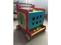 Wooden activity centre and walker