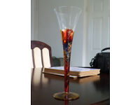 Beautiful decorative glass flute in reds and gold.