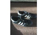 Adidas superstars hardly worn size 5.5. Good condition.