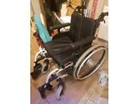 Adjustable width wheel chair
