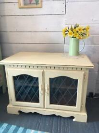 Cream Tv cabinet with lead glass doors