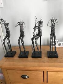 Quartet of metal instrumental ornaments