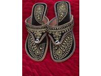 Black and gold handcrafted sandals