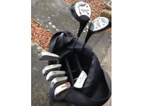 SELECTION OF GOLF CLUBS WITH GOLF BAG AND BALLS.