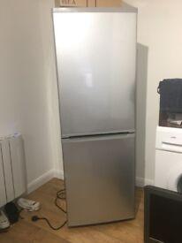 Silver fridge freezer, small dent in freezer door 1 year old