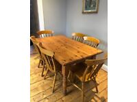 Pine dining table and 6 matching pine chairs