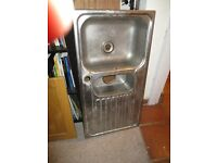 Stainless steel kitchen sink with left hand drainer