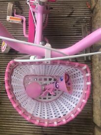 Kids first bike. Halfords Cupcake with Accessories