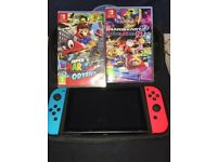 Nintendo switch comes with box and 2 games