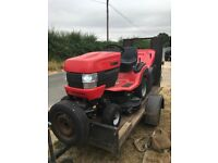 Westwood ride on tractor mower. Less than a year old. With trailer