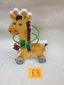 Giraffe beaded toy