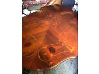 Beautiful wood dining table for sale doesn't come with the chairs but will fit 6