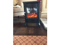 Electric stove with flame effect