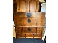 Chinese marriage type cupboard with lift top above pair of cupboard by two drawers, drawers under