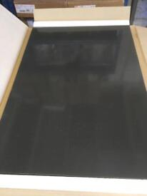 Anthracite gloss slab kitchen doors and wall panel