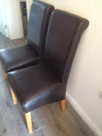2 High back Brown leather dining chairs