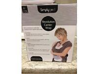 Brand new baby carrier-sling in box RPP £50