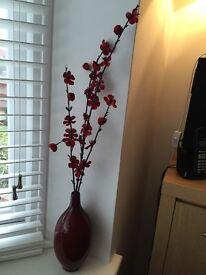 Red ceramic vase with red velvet flowers