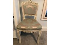 Antique-style upholstered bedroom/occasional chair