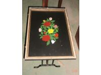 Glass coffee table with flowerly painted picture