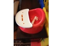 Red Bumbo baby seat with tray and safety belt - excellent condition