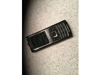 Nokia 6500 classic mobile phone (locked to Vodaphone) with charger, instruction booklet & disc