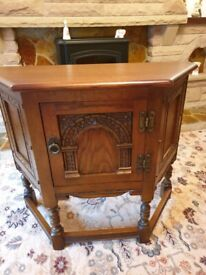 Solid oak old charm furniture table and cabinet/cupboard.