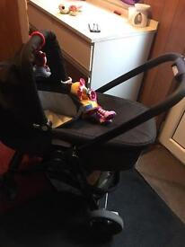 Pushchair with carrycot, parent facing and raincover