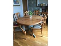Beautiful reconditioned extension table and 6 chairs