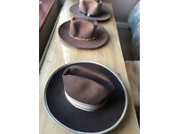Three western style hats