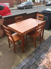 Lovely solid pine dining table with 4 chairs