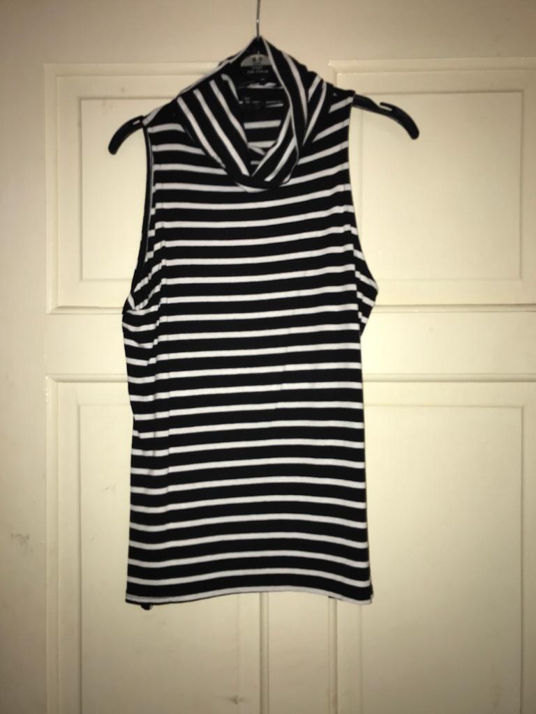 1d2e92ea6f34a7 Black   white striped sleeveless roll neck top
