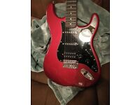 Candy red Fender Squier Strat electric guitar + accessories bought in Matchetts