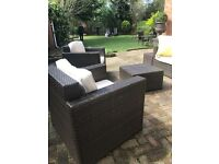 Brown rattan sofa 2 chairs, side table, centre table, parasol
