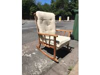 Wooden rocking chair with cushions