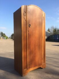 Single Beamish teak wardrobe, shaped door with small carved detailing, shelves to both sides