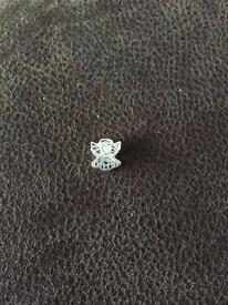 Silver angle charm from truth