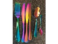 16 Piece iridescent cutlery set includes 4 knifes 4 forks 4 large spoons & 4small spoons